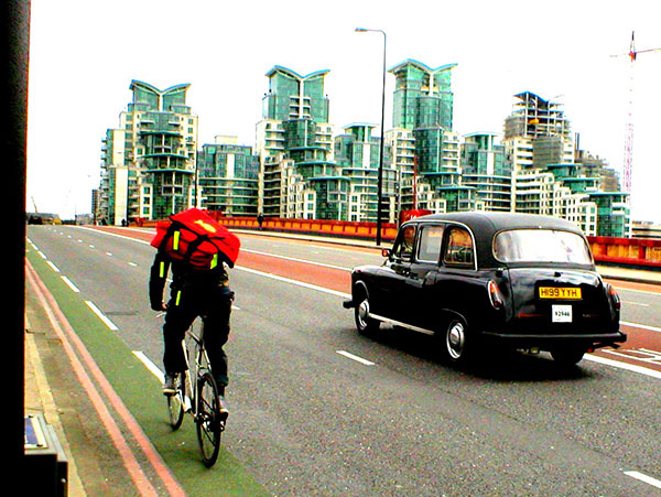 Cyclist and taxi driver on London road | 11 Ridiculous British Laws